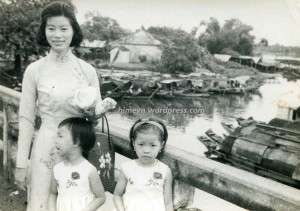 For the first time in my life, war and VCs appeared at my doorsteps. (7-year-old hiMe (left), her mother and her late 8-year-old sister. Picture taken over Perfume river, Hue).